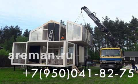 Манипулятор на строительстве двух этажного дома