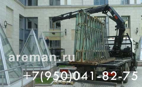 Монтаж стеклянных конструкций вакуумным подъемником